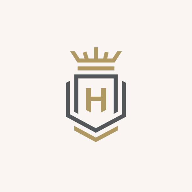Heraldic Letter H monogram. Elegant minimal logo design. Letter H + Crown + Book + Shield. Heraldic Letter H monogram. Elegant minimal logo design. Letter H + Crown + Book + Shield. shield stock illustrations