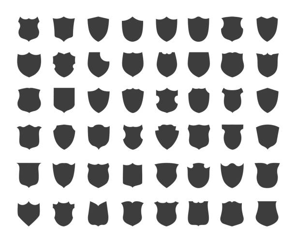 Heraldic shield silhouettes Heraldic shield silhouettes. Blank vintage shields shape icons for secure labels or heraldic emblems, black insurance and defence badges, vector illustration shield stock illustrations