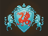 Vector image of a silver heraldic shield with a red dragon in the center and with silver unicorns on the edges on a dark background. Coat of arms, heraldry, emblem, symbol. Color image.