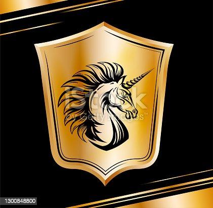 istock Heraldic shield with Unicorn horse head. Golden emblem 1300848800