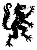 Black vector heraldic rampant wolf on the white background.
