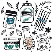 Herbs and spices jars icon set: basil, pepper, rosemary, anise, vanilla, bay leaves. Hand drawn vector kitchen glass bottles and jars. Kitchen line illustration. Doodle style. Isolated on white