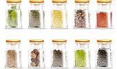 Isolated and colored herbs spices jars icon set in realistic style with different spices inside vector illustration