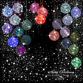 Hexagon multi color disco balls with stars and sparkles on a black background for the Christmas and New Year season of 2019