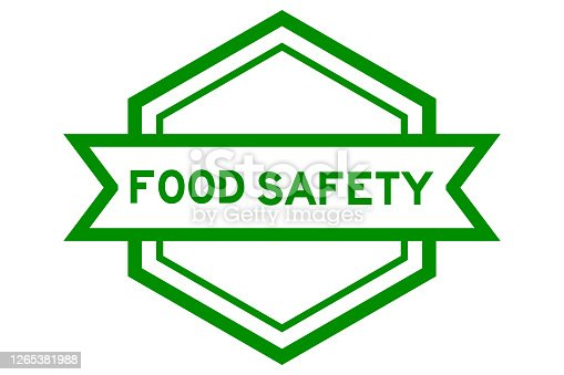 Hexagon vintage label banner in green color with word food safety on white background