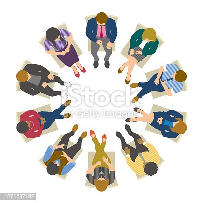 istock High angle view of business people sitting in circle and having meeting 1271537182