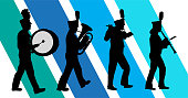 Marching band in silhouettes with blue stripes in the background
