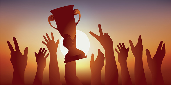 High-level sportsmen raise their winners ' Cup and lift their arms as a sign of victory.