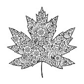 Highly detailed floral pattern made in Mehndi style in form of maple leaf. Decoration flower in ethnic oriental, Indian style.