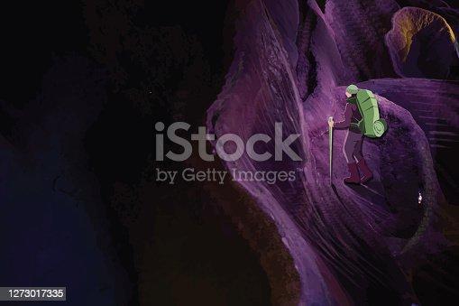 istock Hiker exploring cave 1273017335