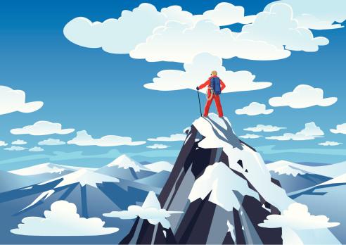 Hiker standing on a mountain peak
