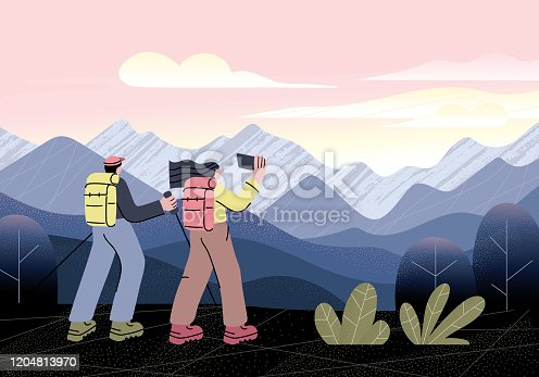 istock Hikers at mountain viewpoint 1204813970