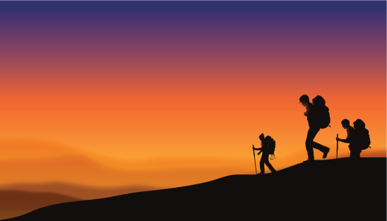 Hikers at Sunset Background