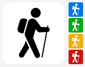 Hiking Icon. This 100% royalty free vector illustration features the main icon pictured in black inside a white square. The alternative color options in blue, green, yellow and red are on the right of the icon and are arranged in a vertical column.