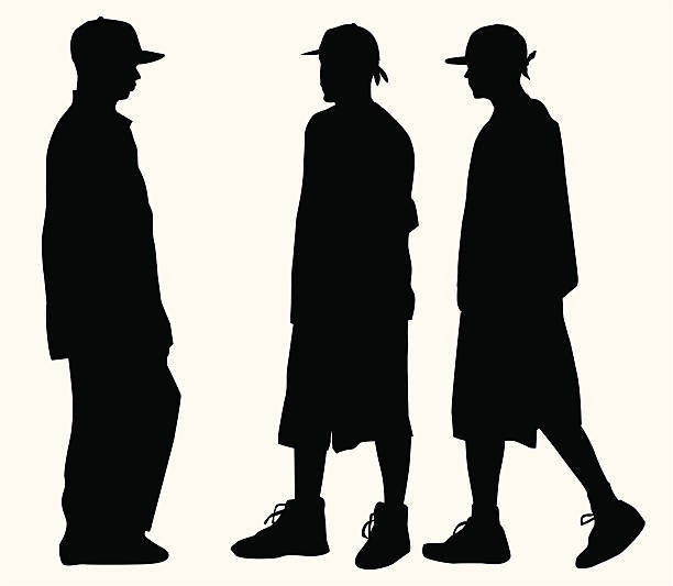 Hip Hop Fashion Teens ( Vector ) Boys in baggy clothes, baseball cap and sneakers. Silhouette. svg stock illustrations
