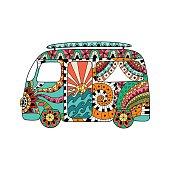 Hippie vintage car a mini van in ornamental style. Colorful hippie bus.
