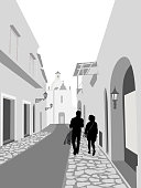 Couple walking down an old street in Europe