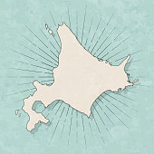 Map of Hokkaido in a trendy vintage style. Beautiful retro illustration with old textured paper and light rays in the background (colors used: blue, green, beige and black for the outline). Vector Illustration (EPS10, well layered and grouped). Easy to edit, manipulate, resize or colorize.
