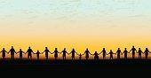 Holding Hands - United Community Sunset Background