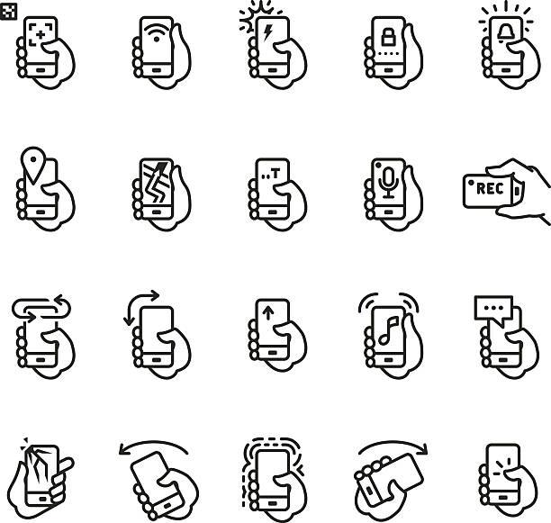hält das telefon apps und aktionen symbol - fotohandy stock-grafiken, -clipart, -cartoons und -symbole