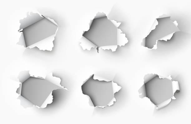 illustrazioni stock, clip art, cartoni animati e icone di tendenza di holes torn in paper on white background - foro