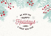 Holiday, Christmas background with greetings, evergreen branches and berries.