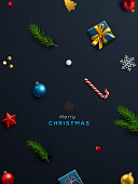 Christmas background, banner, frame, header, background or greeting card design with Christmas decor including baubles, gift box, fir tree cuttings, snowflakes, candy cane, star... Vector Illustration.