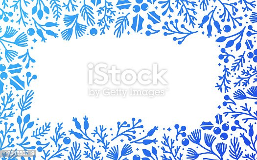 Holiday seasonal berry leaves and branches frame design with space for your copy.