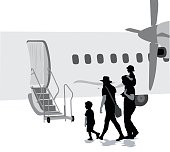 Silhouette vector illustration of a family boarding an aircraft