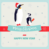 Holiday greeting postcard with penguins