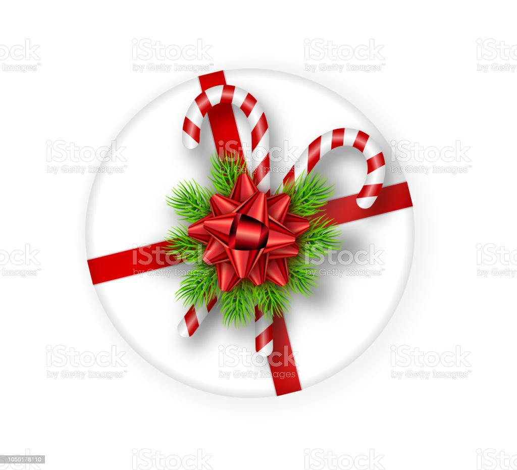 Holiday Round Gift Box With Red Bow Fir Tree Branchesand Candy Canes