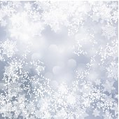 Holiday silver background with snowflakes and bokeh lights
