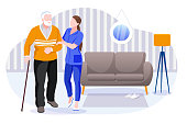 Home care services for seniors. Nurse or volunteer worker taking care of elderly disabled man. Vector flat cartoon characters and room interior illustration. Healthcare and social support concept