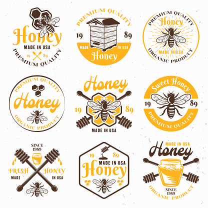 Honey and apiary set of colored vector emblems, labels, badges and signs for package design isolated on light background
