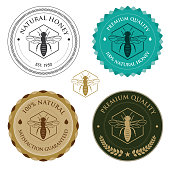 Badges with bee for honey production. Eps8. All design elements are layered and grouped.