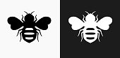 Honey Bees Icon on Black and White Vector Backgrounds. This vector illustration includes two variations of the icon one in black on a light background on the left and another version in white on a dark background positioned on the right. The vector icon is simple yet elegant and can be used in a variety of ways including website or mobile application icon. This royalty free image is 100% vector based and all design elements can be scaled to any size.