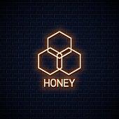 Honey comb neon banner. Organic honey neon sign on wall background 10 eps