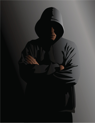 Hooded Man in the Shadows