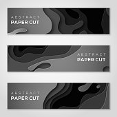 Horizontal banners with black paper cut shapes.