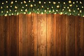 Realistic blank wooden wall with bright Christmas garland.