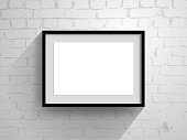 blank horizontal frame on brick wall
