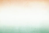 A horizontal vector illustration of three horizontal colored bands in saffron, white and green, with width of entire frame. Orange color is at the top edge and green color is at the bottom edge. The orange and green colors at the top and bottom, fade into the white color in the middle, blending softly.  A calm peaceful patriotic theme faded wallpaper. No people. No text. The background has Copy space for text. Soft colors or hues blending into each other. These colors are in the flag of India, Niger and also of Ireland and Côte d'Ivoire (Ivory Coast) country. Can be used for national festivals, events, national teams related backdrops of these countries. The background is slightly aberrated, scratched. The colours are very very light, soft and pastel.