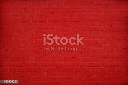 A dark bold red colored brick wall with rectangular blocks, textured grungy backgrounds. No text. No people, copy space, copyspace.  The masonry joints joint are red in color.  Xmas, Christmas theme backgrounds