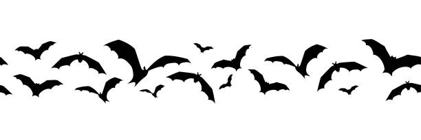 Horizontal seamless background with bats. Vector illustration. Vector horizontal seamless background with bats on a white background. bat stock illustrations