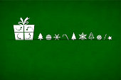 A bright green coloured horizontal vector illustration of a christmas background with a big gift box and small objects like candy cane, xmas trees, snowflakes, baubles, stars and swirl arranged beautifully. Apt for Xmas, Christmas, New Year Day New year's eve, holiday, vacation, vacations  theme backgrounds, greeting card, poster and backdrop. Looks like an envelope sealed with xmas ornaments.