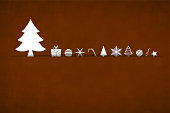 A coffee brown coloured horizontal vector illustration of a christmas background with small objects like gift box, candy cane, xmas trees, snowflakes, baubles, stars and swirl arranged beautifully. Apt for Xmas, Christmas, New Year Day New year's eve, holiday, vacation, vacations  theme backgrounds, greeting card, poster and backdrop. Looks like an envelope sealed with xmas ornaments.