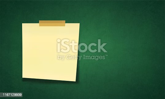 istock A horizontal vector illustration of a pale yellow coloured sticky note over a green board 1167129939