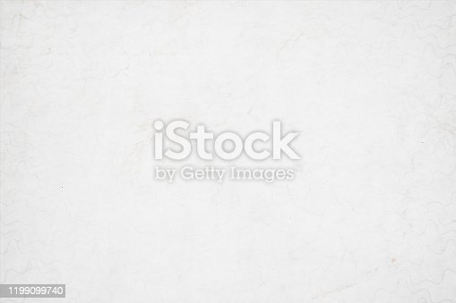 istock A horizontal vector illustration of a plain grunge effect blank white colored old blotched background 1199099740