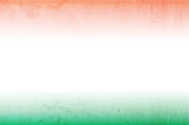 A horizontal vector illustration of tricolour flag in three bands in saffron, white and green colors. The orange and green at the top and bottom, blend into the off white central band. A peaceful patriotic theme faded wallpaper. Apt for use of national festivals of India, Niger and also of Ireland and Côte d'Ivoire (Ivory Coast).