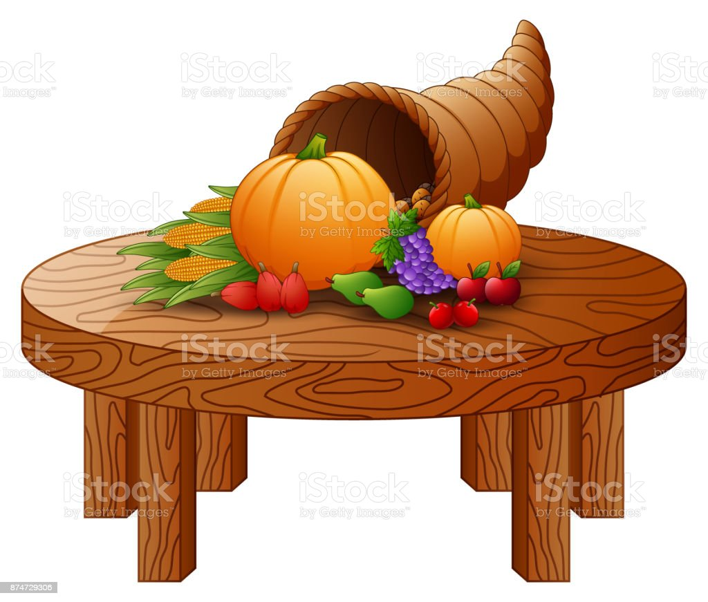 horn of plenty with vegetables and fruits on round wooden table